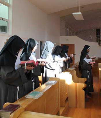 Nuns in chapel praying