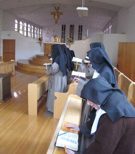 Nuns praying in church